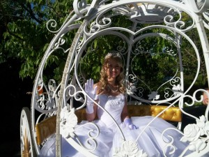 Bride through heart shaped window of Cinderella Carriage