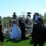 La Quinceanera, her escort . cinderella carriage, vasqueros in backgound