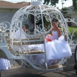 Quinceanera in her cinderella carriage on the way to the church